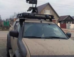 Стул стрелковый на крыше машины